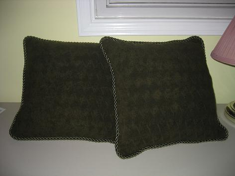 Olive pillows made from upholstry fabric and cording.